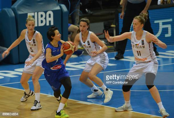 Kim Mestdagh and Emma Meesseman both of Belgium try to block Giorgia Sottane of Italy during the FIBA EuroBasket women's quarterfinal match between...