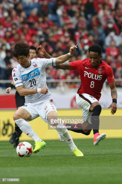 Kim Min Tae of Consadole Sapporo and Rafael Silva of Urawa Red Diamonds compete for the ball during the JLeague J1 match between Urawa Red Diamonds...