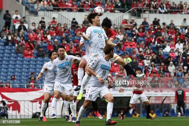 Kim Min Tae of Consadole Sapporo and Wataru Endo of Urawa Red Diamonds compete for the ball during the JLeague J1 match between Urawa Red Diamonds...