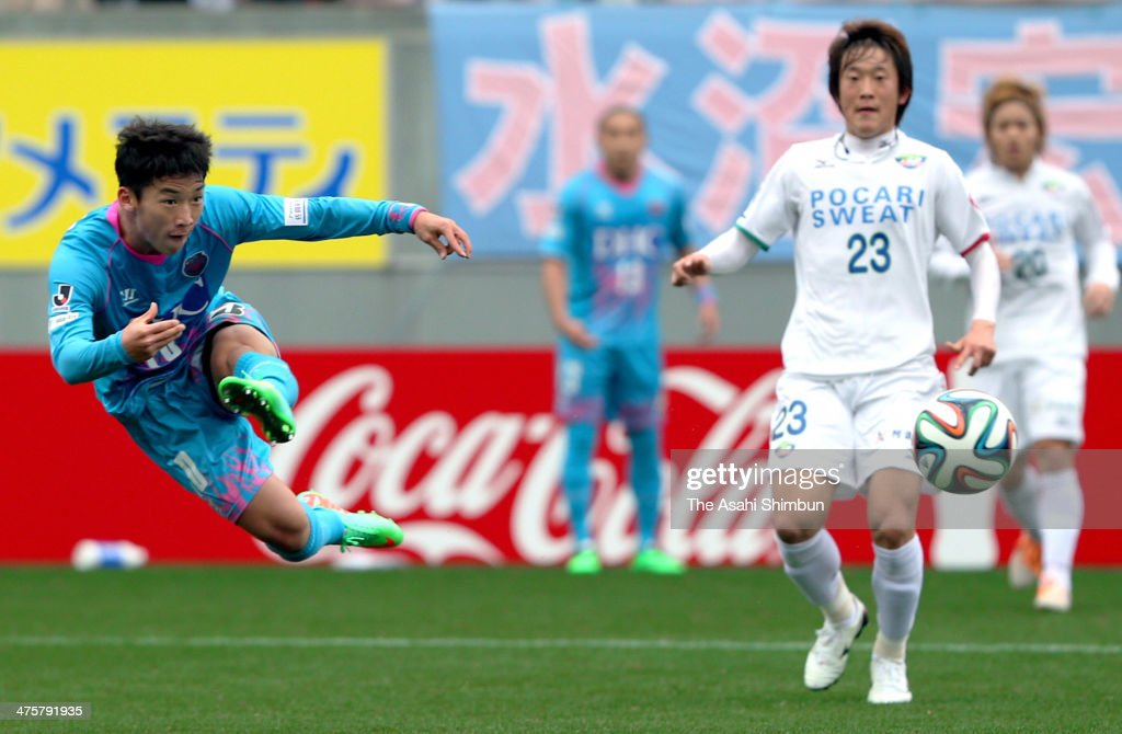 Kim Min Woo (L) of Sagan Tosu scores his team's first goal during the J.League match between Sagan Tosu and Tokushima Vortis at Best Amenity Stadium on March 1, 2014 in Tosu, Saga, Japan.