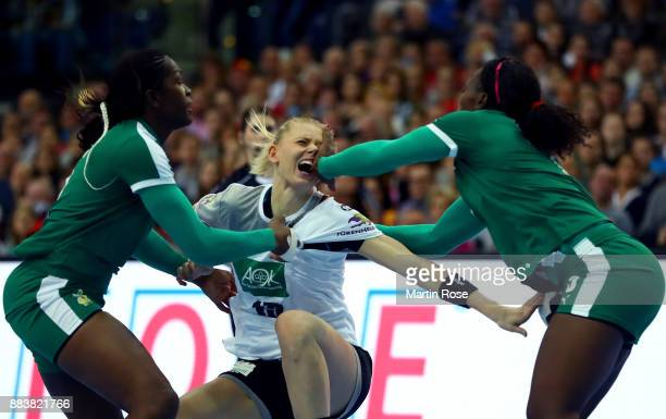 Kim Naidzinavicius of Germany is attacked by Pasma Nchouapouognigni of Cameroon during the IHF Women's Handball World Championship group D match...