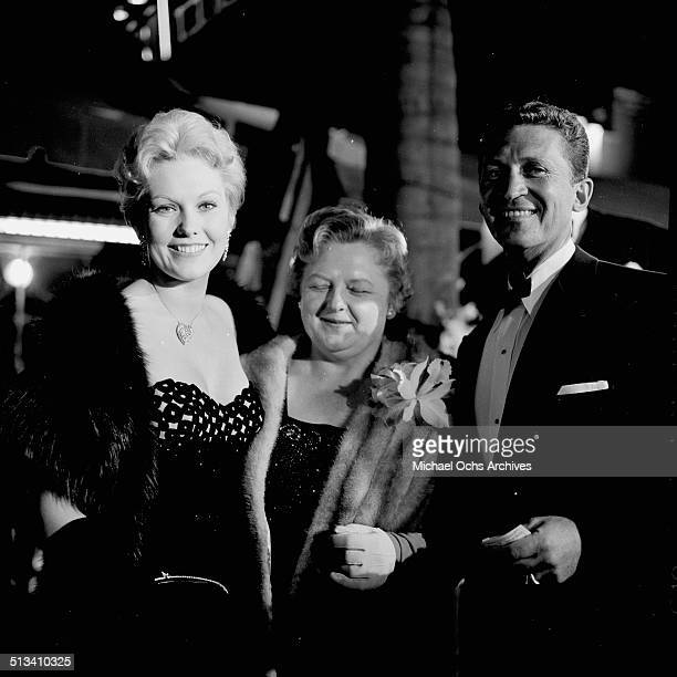 Kim Novak her mother Blanche and Mac Krim attend the movie premier of 'The Tall Man' in Los AngelesCA