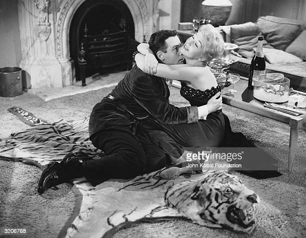 Kim Novak seduces a startled Jack Lemmon on a tiger skin rug in 'Phffft' directed by Mark Robson