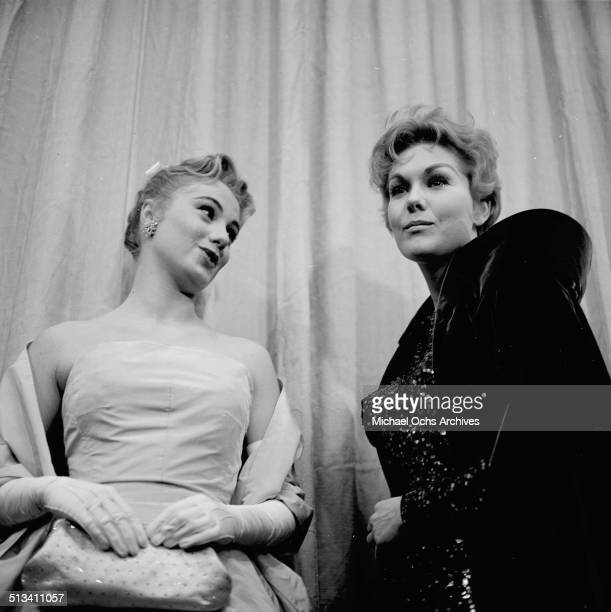 Kim Novak with Shirley Jones attend the Academy Awards in Los AngelesCA