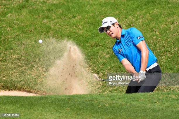 T Kim of Korea hits out of a greenside bunker on the 16th hole during round two of the World Golf Championships Dell Technologies Match Play at...