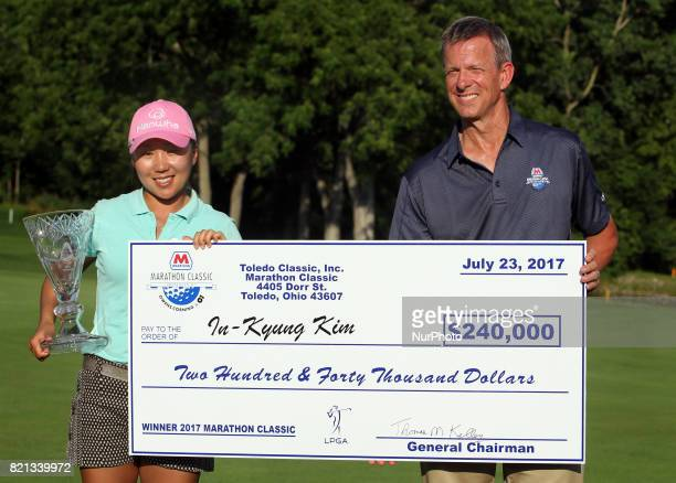 IK Kim of Korea holds the check and trophy after winning the tournament during the final round of the Marathon LPGA Classic golf tournament at...
