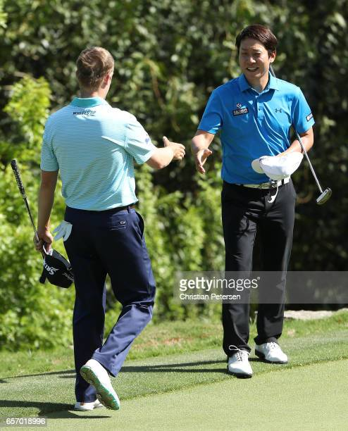 T Kim of Korea shakes hands with Russell Knox of Scotland after winning their match during round two of the World Golf ChampionshipsDell Technologies...
