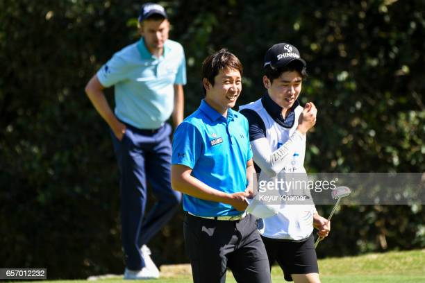 T Kim of Korea smiles after his 31 victory against Russell Knox of Scotland on the 17th hole green during round two of the World Golf Championships...