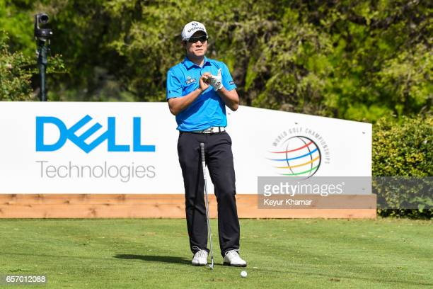 T Kim of Korea stretches his fingers before teeing off on the 17th hole during round two of the World Golf Championships Dell Technologies Match Play...
