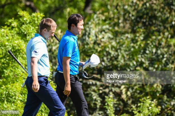 T Kim of Korea walks with Russell Knox of Scotland after his 31 victory on the 17th hole green during round two of the World Golf Championships Dell...