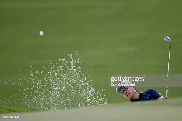 T Kim of South Korea plays a shot from a bunker on the third hole during the third round of the 2017 PGA Championship at Quail Hollow Club on August...