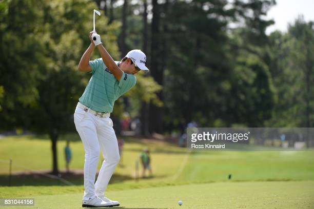 T Kim of South Korea plays his shot from the eighth tee during the final round of the 2017 PGA Championship at Quail Hollow Club on August 13 2017 in...