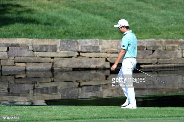 T Kim of South Korea walks along on the seventh green during the final round of the 2017 PGA Championship at Quail Hollow Club on August 13 2017 in...