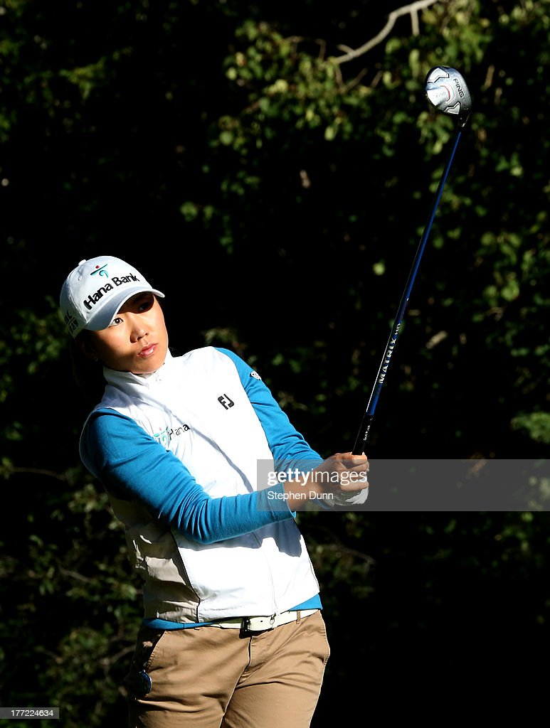 I.K. Kim of South Korea watches her tee shot on the sixth hole during the CN Canadian Women's Open at Royal Mayfair Golf Club on August 22, 2013 in Edmonton, Alberta, Canada.