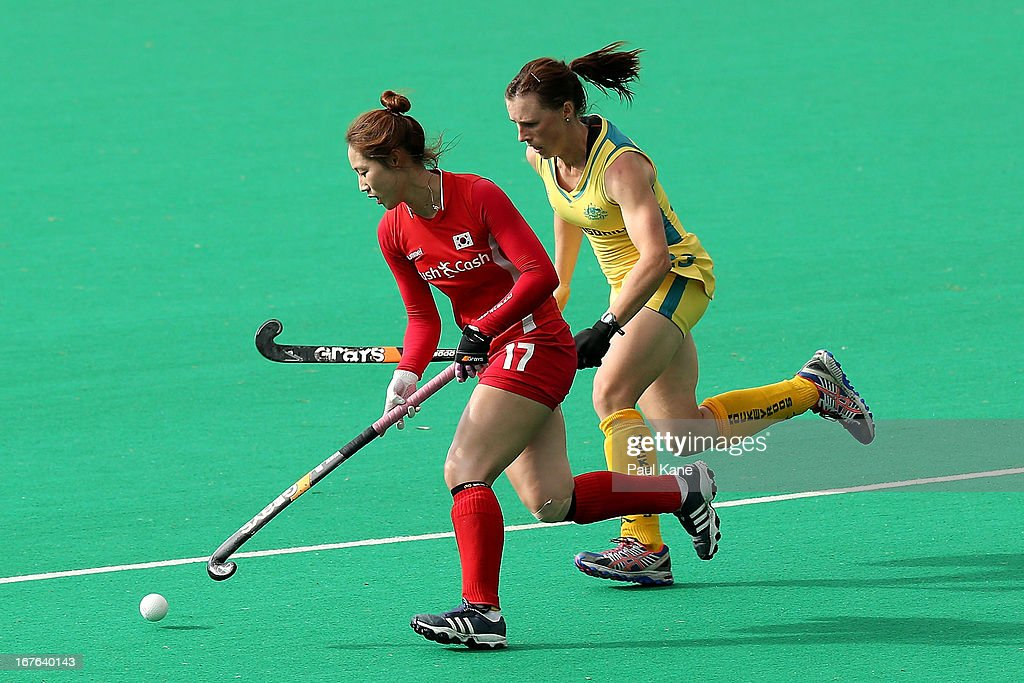 Kim Ok Ju of Korea controls the ball against Claire Messent of Australia during the International Test match between the Australian Hockeyroos and Korea at Perth Hockey Stadium on April 27, 2013 in Perth, Australia.