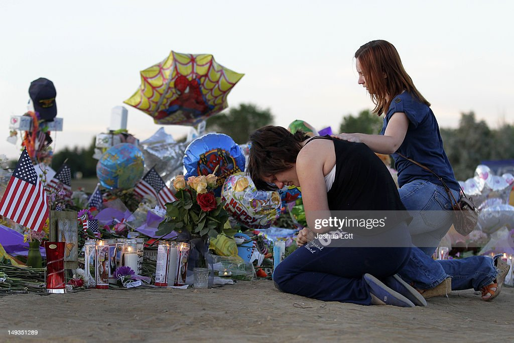 Kim Pasic places her hand on the back of Ashleigh Grove as she grieves over the lost of her friend Micayla Medek at the makeshift memorial for the 12...