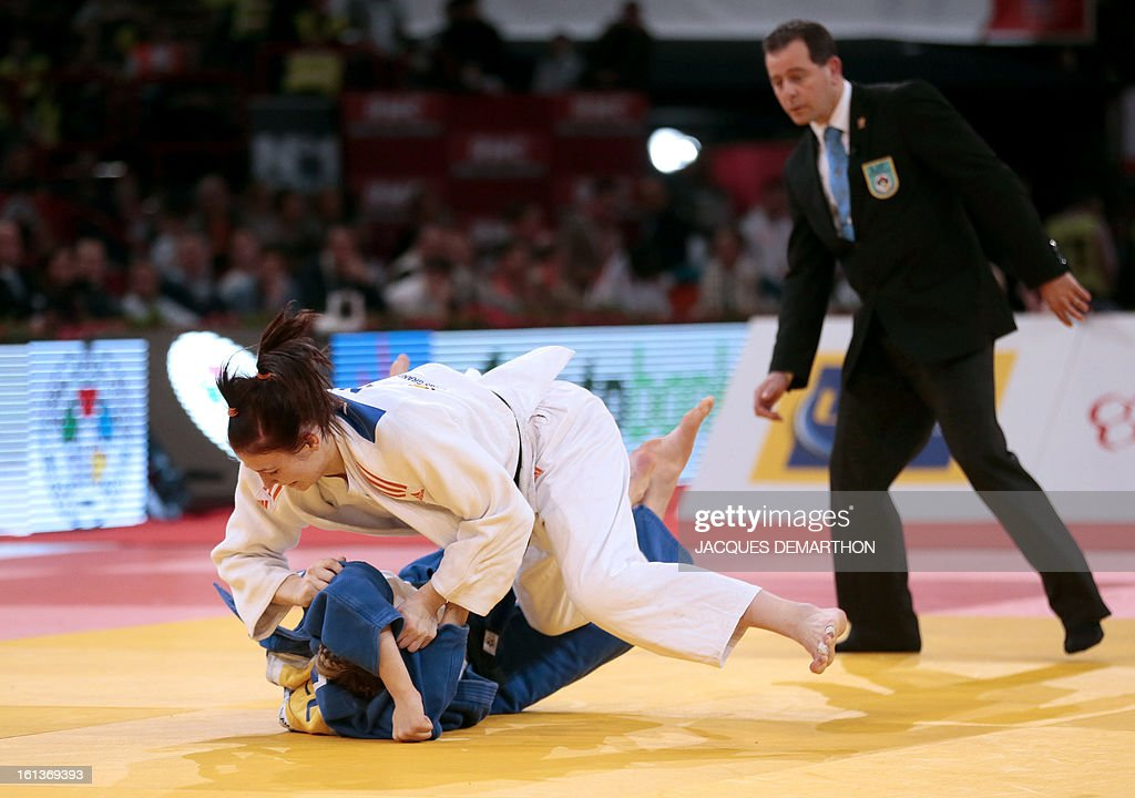 Kim Polling of the Netherlqnds (Up) competes against Canada's Kelita Zupancic (Bottom) on February 10, 2013 during the Women -70Kg final of the Paris International Judo tournament, part of the Grand Slam, at the Palais Omnisports de Paris-Bercy (POPB) in Paris.