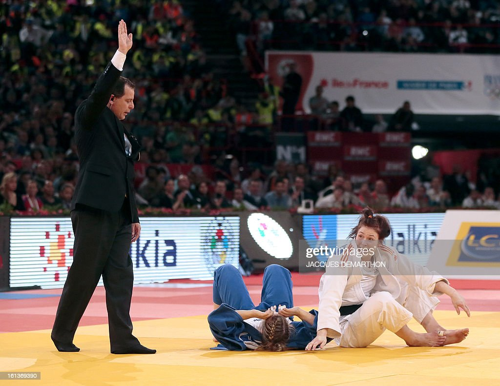 Kim Polling of the Netherlqnds (R) defeats Canada's Kelita Zupancic (C) on February 10, 2013 during the Women -70Kg final of the Paris International Judo tournament, part of the Grand Slam, at the Palais Omnisports de Paris-Bercy (POPB) in Paris. AFP PHOTO / JACQUES DEMARTHON