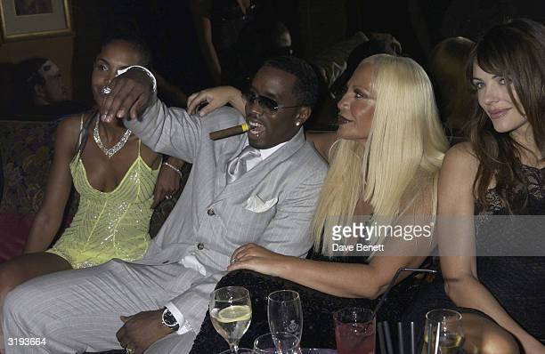 Kim Porter singer Sean Combs designer Donatella Versace and model Elizabeth Hurley attend the Versace Couture Launch Party at The Ritz Hotel on 9th...