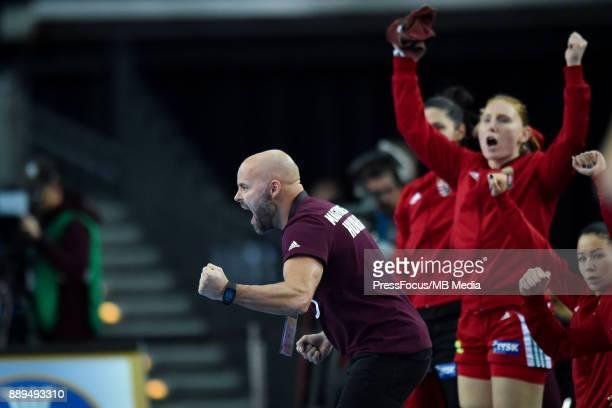 Kim Rasmussen head coach of Hungary celebrates his team scoring a goal during IHF Women's Handball World Championship round of 16 match between...