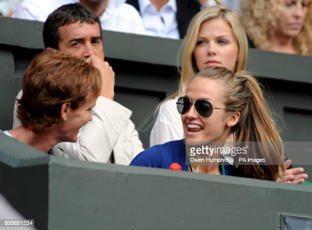 Kim Sears and Judy Murray watch Great Britain's Andy Murray in action against USA's Andy Roddick during the Wimbledon Championships at the All...