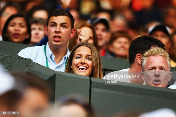 Kim Sears girlfriend of Andy Murray is happy as she watches his Gentlemen's Singles third round match against Roberto Bautista Agut on day five of...