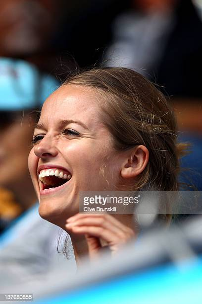Kim Sears girlfriend of Andy Murray laughs at a joke whilst Murray plays in his quarter final match against Kei Nishikori of Japan during day ten of...