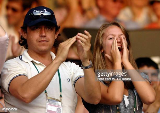Kim Sears the partner of Scotland's Andy Murray cheers on his victory against USA's Andy Roddick during the third round of The All England Lawn...