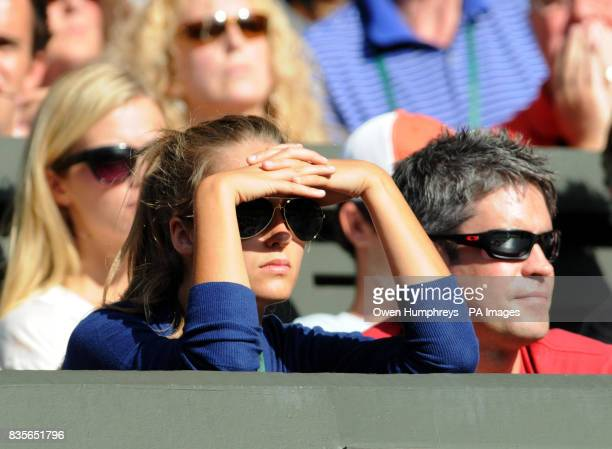 Kim Sears watches Andy Murray on Centre Court during the Wimbledon Championships at the All England Lawn Tennis and Croquet Club Wimbledon London