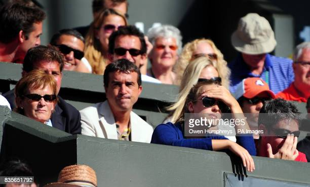 Kim Sears watches Andy Murray play Andy Roddick on Centre Court during the Wimbledon Championships at the All England Lawn Tennis and Croquet Club...