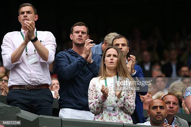 Kim Sears wife of Britain's Andy Murray watches him play France's JoWilfried Tsonga during their men's singles quarterfinal match on the tenth day of...