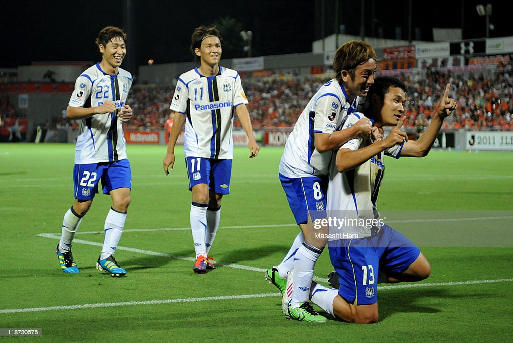 Kim Seung Yong #13 of Gamba Osaka (R) celebrates his goal with his teammates Hayato Sasaki #8 (2R),Takashi Usami #11 (3R),Lee Keun Ho #22 (4R) during the J.League match between Omiya Ardija and Gamba Osaka at Nack 5 Stadium on July 10, 2011 in Saitama, Japan.