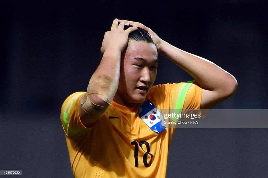 Kim Seungha of Korea Republic reacts after saving the penalty to beat Iceland in the penalty shoot out after full time 1-1 draw during the 2014 FIFA Boys Summer Youth Olympic Football Tournament Semi Final match between Korea Republic and Iceland at Jiangning Sports Centre Stadium on August 24, 2014 in Nanjing, China.