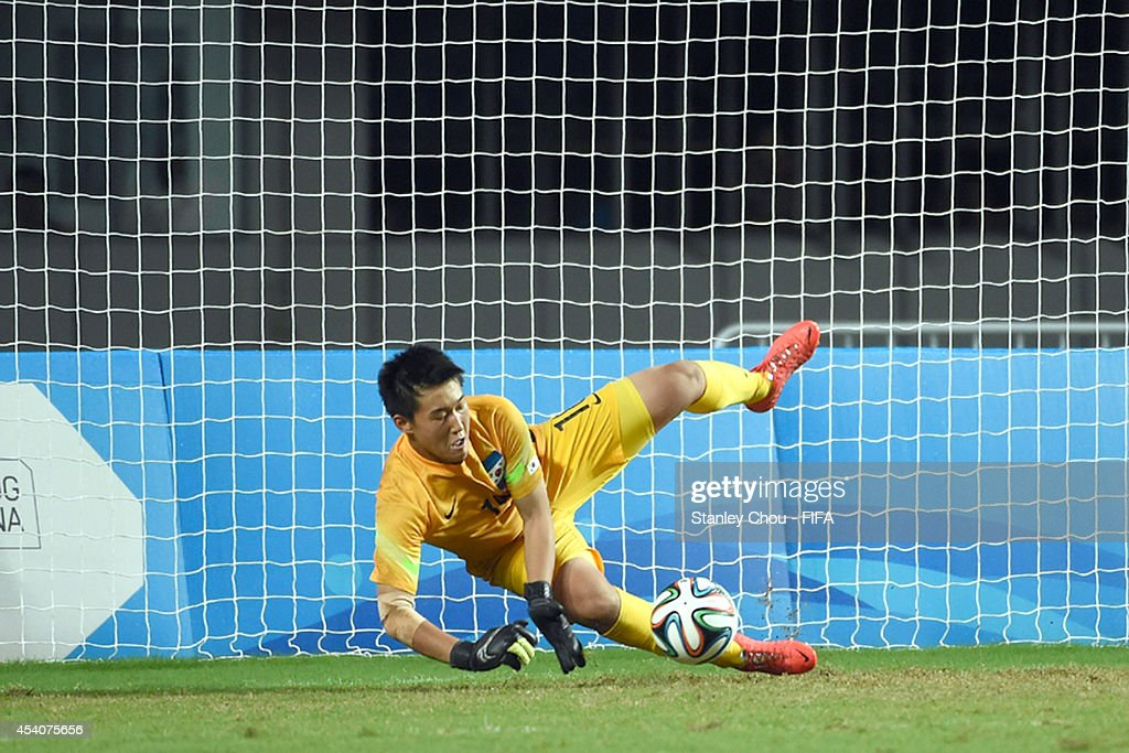Kim Seungha of Korea Republic saves the 1st penalty in the penalty shoot out after full time 1-1 draw during the 2014 FIFA Boys Summer Youth Olympic Football Tournament Semi Final match between Korea Republic and Iceland at Jiangning Sports Centre Stadium on August 24, 2014 in Nanjing, China.