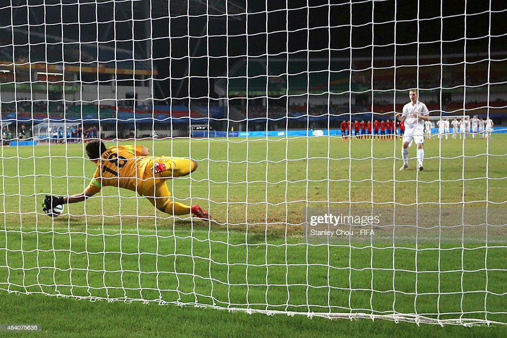 Kim Seungha of Korea Republic saves the penalty to beat Iceland 3-1 in the penalty shoot out after full time 1-1 draw during the 2014 FIFA Boys Summer Youth Olympic Football Tournament Semi Final match between Korea Republic and Iceland at Jiangning Sports Centre Stadium on August 24, 2014 in Nanjing, China.