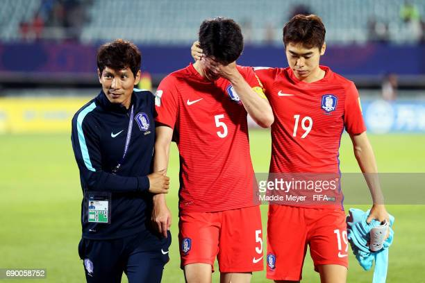 Kim Seungwoo of Korea Republic comforts Lee Sangmin after their 31 loss to Portugal in the FIFA U20 World Cup Korea Republic 2017 Round of 16 match...