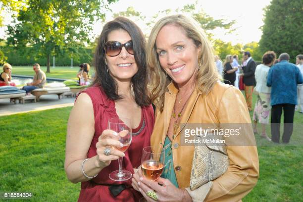 Kim Seybert and Virginia DiGiacomo attend GODS LOVE WE DELIVERMid Summer Night Drinks Benefit at Home of Chad A Leat on June 19 2010 in Bridgehampton...