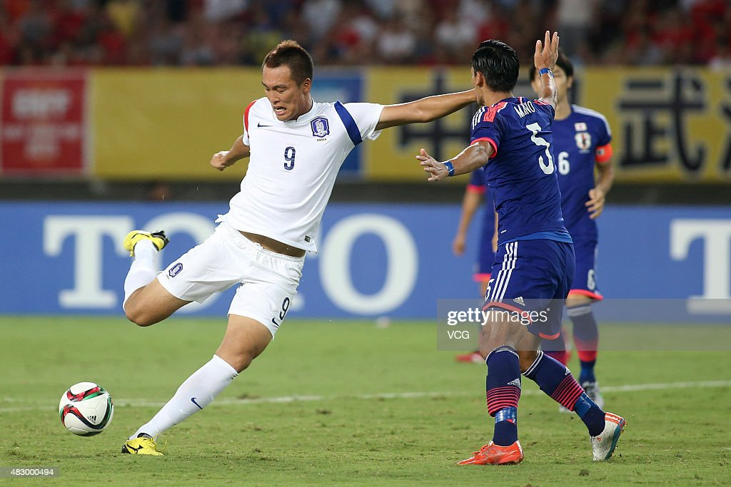 Kim Shin-wook #9 of South Korea kicks the ball in group match between Japan and South Korea during EAFF East Asian Cup 2015 at Wuhan Sports Center Stadium on August 5, 2015 in Wuhan, Hubei Province of China.