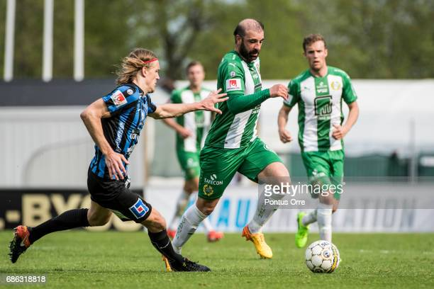 Kim Skoglund of IK Sirius FK and Kennedy Bakircioglu of Hammarby IF competes for the ball during the Allsvenskan match between IK Sirius FK and...