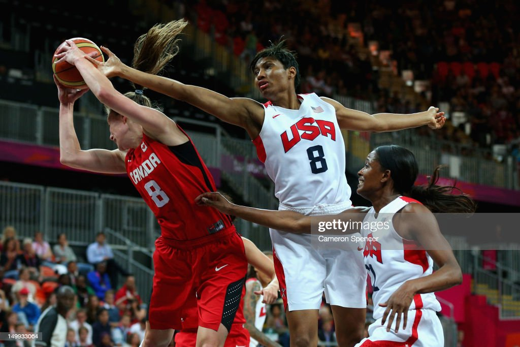 Kim Smith of Canada and <a gi-track='captionPersonalityLinkClicked' href=/galleries/search?phrase=Angel+McCoughtry&family=editorial&specificpeople=4423621 ng-click='$event.stopPropagation()'>Angel McCoughtry</a> of the United States contest the ball during the Women's Basketball quaterfinal between Canada and the United States on Day 11 of the London 2012 Olympic Games at the Basketball Arena on August 7, 2012 in London, England.