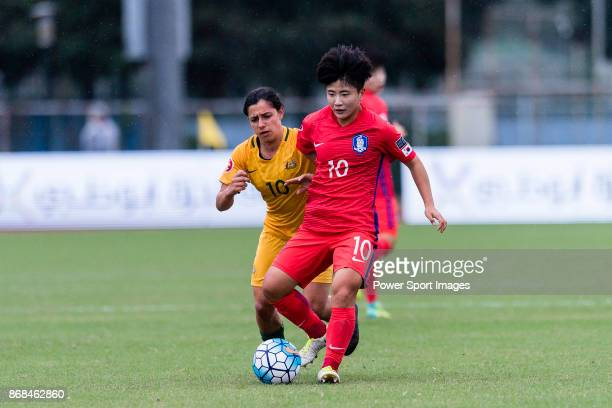 Kim Soeun of South Korea fights for the ball with Alexandra Chidiac of Australia during their AFC U19 Women's Championship 2017 Group Stage B match...