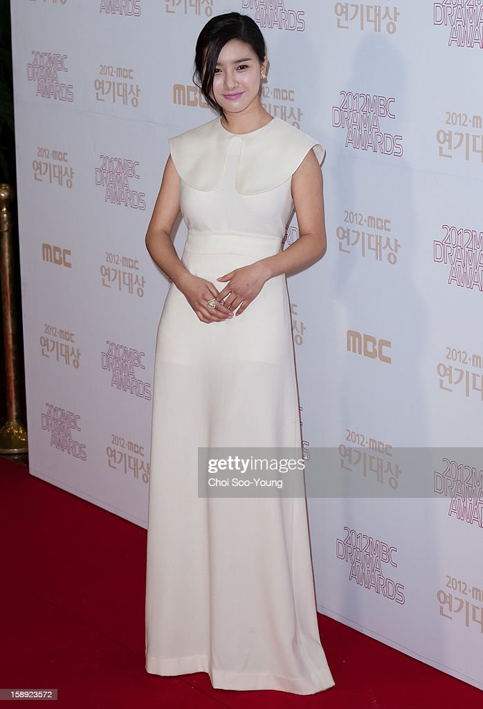 <a gi-track='captionPersonalityLinkClicked' href=/galleries/search?phrase=Kim+So-Eun&family=editorial&specificpeople=6670654 ng-click='$event.stopPropagation()'>Kim So-Eun</a> poses for photographs upon arrival during the 2012 MBC Drama Awards at MBC Open Hall on December 30, 2012 in Seoul, South Korea.