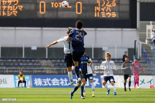 Kim Song Gi of Machida Zelvia and Kazuyoshi Miura of Yokohama FC compete for the ball during the JLeague J2 match between Machida Zelvia and Yokohama...