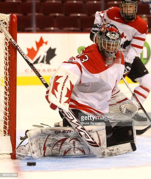 Kim StPierre of Team Canada tends net in warmups prior to her game against Team Sweden during the Hockey Canada Cup at General Motors Place on August...