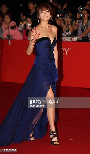 Kim SunA arrives for the opening ceremony of the 18th Busan International Film Festival at Busan Cinema Center on October 3 2013 in Busan South Korea