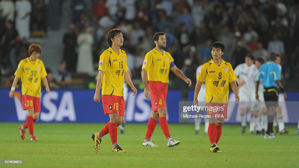 Kim Sung Hwan and Choi Sung Kuk of Seongnam Ilhwa Chunma F.C. look dejected after the 2nd Inter Milan goal during the FIFA Club World Cup match between Seongnam Ilhwa Chunma FC and Inter Milan at Zayed Sports City on December 15, 2010 in Abu Dhabi, United Arab Emirates.