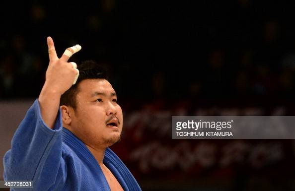 Kim SungMin of South Korea celebrates his victory over Rafael Silva of Brazil during their men's over 100kg final match in the Grand Slam Tokyo 2013...
