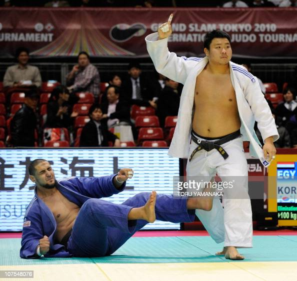 Kim SungMin of South Korea reacts as he celebrates his victory against Islam El Shehaby of Egypt during men's over 100kg class quarterfinal round...