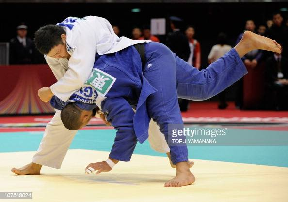 Kim SungMin of South Korea throws Islam El Shehaby of Egypt during men's over 100kg class quarterfinal round match in the Judo Grand Slam Tokyo judo...