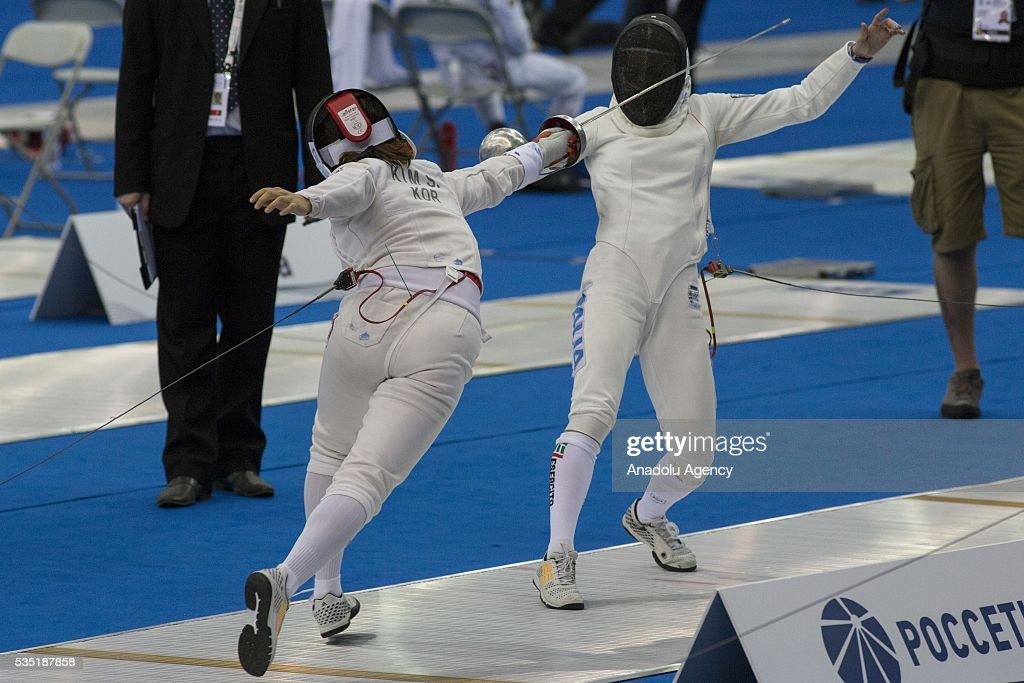 Kim Sunwoo (L) from Korea and Bonessio Lavinia from Italy compete in the fencing at the mixed relay World Championship in modern pentathlon in Olympic Sports Complex in Moscow, Russia, on May 29, 2016.